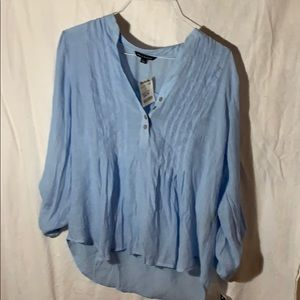 Casual light blue linen blouse